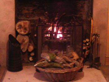 Kates Guest House B&B Carlisle - Sandstone open fireplace with log fire on those chilly Winter mornings