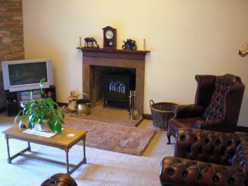 A Cosy and Traditional Lounge - (View 2)