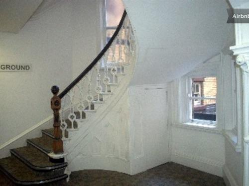 Stairs continuing up - notice Victorian Gothic detail in building.