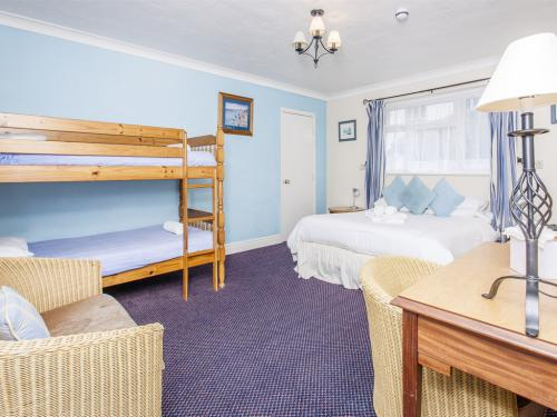 Room 11, A large family size room, consist of bunk beds and a kingsize bed.