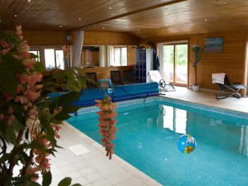 Treetops Cottages & Spa - Enjoy our lovely environmentally heated swimming pool