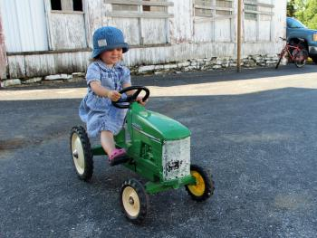Ride a pedal tractor