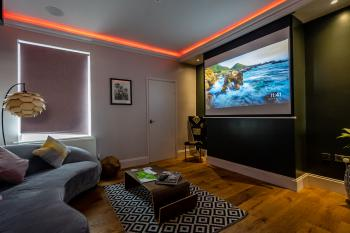 Living area with automated hidden projector