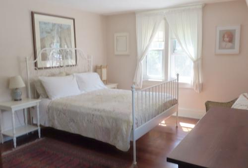 White Room with queen bed and private bath