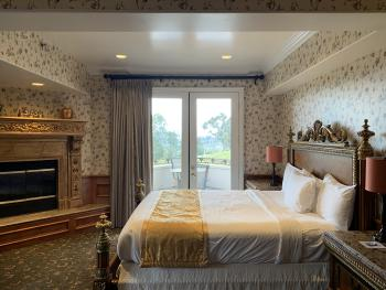 king bed with fire place and beautiful views