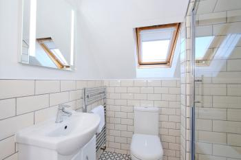 Top floor shower room with electric shower, always gleaming for your arrival.  Please be assured Ben Shea is deep cleaned and disinfected to best practice standards between stays