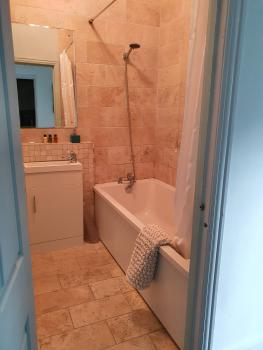 Lux Apatment self contained family bathroom with heated towel rail and various shampoos provided.