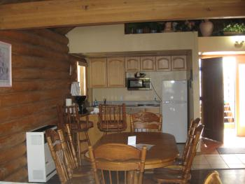 CABIN #5 is our ONLY cabin that has a kitchenette, a FULL size fridge,table for 6,PRIVATE bathroom and a bar(SLEEPS UP TO 4)