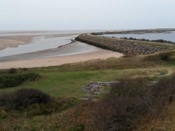 Sea wall, the lagoon and the Duddon Estuary