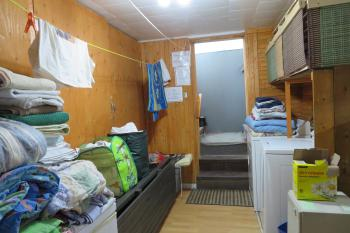 Laundry room, with clean bedsheets