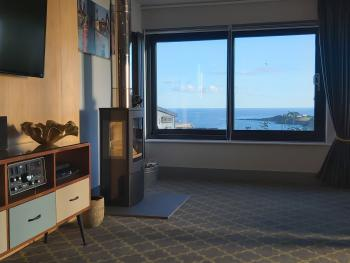 Log burner and sea views from large Lounge