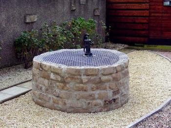 Our very own historic well in the back garden