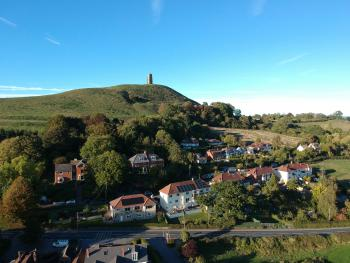 Aerial shot of Little Orchard on Southern Slopes of Glastonbury Tor