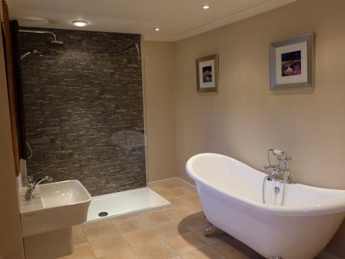 Monsoon Shower & Roll Top Bath