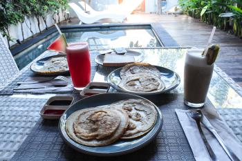 Breakfast served by the pool in your private villa