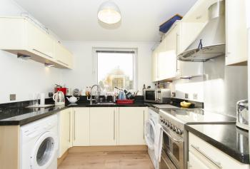 Well-equipped kitchen with granite worktops, washing machine and tumble dryer