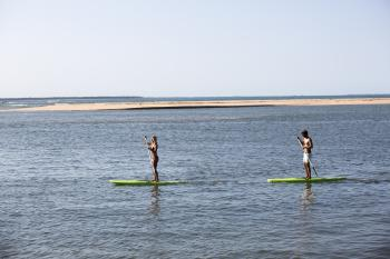 StandUp paddling right in front of KA BRU Beach Boutique Hotel