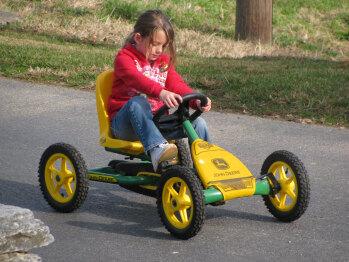 Fun riding our pedal go-carts around the farm