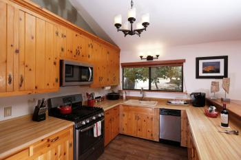 Country kitchen with all new appliances.