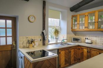 kitchen with wonderful views and stable door to rear courtyard
