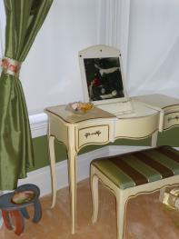 The room's furniture is French provincial and the room also has two soft n' cozy chairs for reading or watching TV.