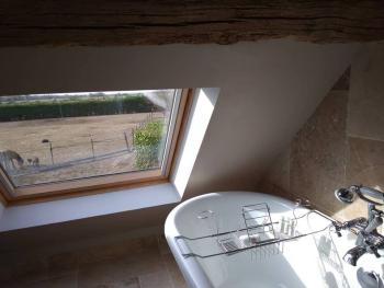A view of the mini-farm and valley from the bath in Les Étoiles.