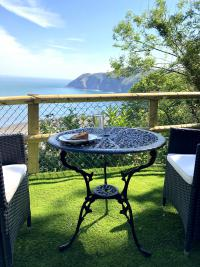 Garden seating area overlooking Lynmouth Bay