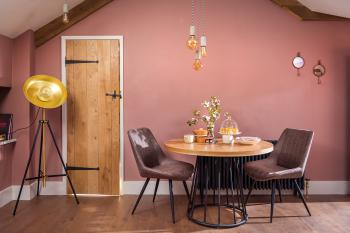 Dining area with vaulted ceiling