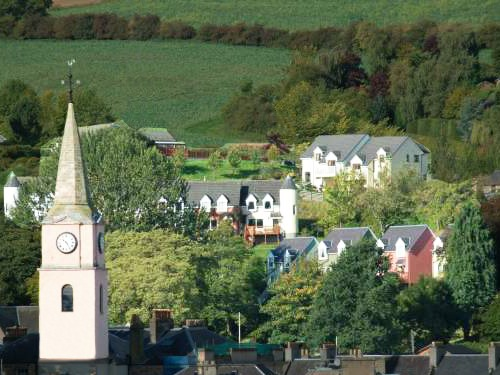 Larkhall Burn cluster of cottages set on a hillside. The town clock marks the centre of historic Royal Burgh of Jedburgh. Town facilities close-by.