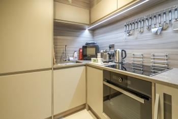 Private kitchen with all the utensils you would need to cook up a meal!