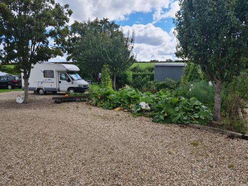 Motor Home-Part Sloping Pitch-Basic-Shared Bathroom-Countryside view - Base Rate
