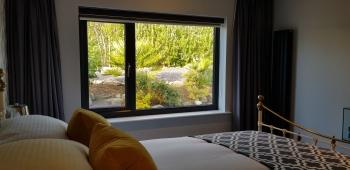 Second bedroom with peaceful garden views