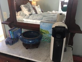 Nespresso coffee maker and supplies
