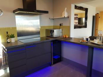 Plenty of space in the contemporary kitchen to cook up your local produce