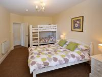 Superior Family Suite which sleeps 6 - Double & Bunks bedroom with Cliff Railway view