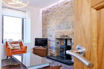 A warm welcome awaits with a wood burning stove and comfy seating