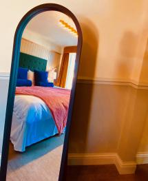 Each room has fluffy pillows, comfortable beds and gorgeous headboards adding a pop of colour.