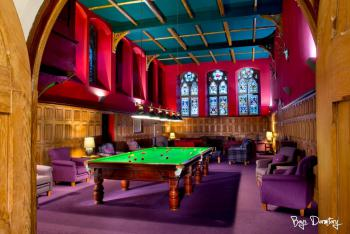 Billiards and relaxing areas in the old monks' refectory