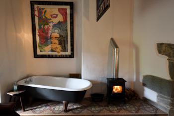 '1550' with a wood burning stove and freestanding cast iron bath