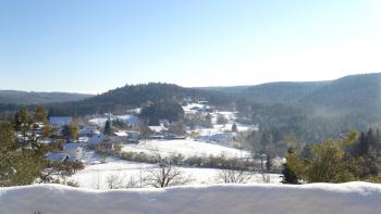 Le village de Liézey sous la neige