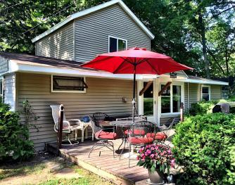 Backside/roadside deck is handy for grilling and more outside seating.