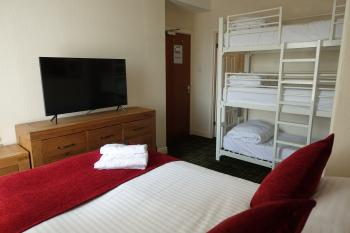 Guest room for 5 with triple bunk beds