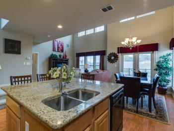 Large granite island kitchen opens onto the dining, and living room.