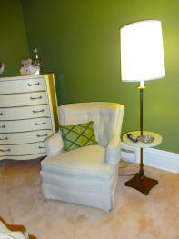 Furniture is French provincial with two soft n' cozy chairs for reading or watching TV.