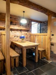 Cozy sitting area in the bar with characterful barn features