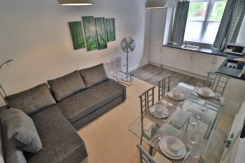 A cosy self-contained 1-bed flat with a small but fully-kitted kitchen.