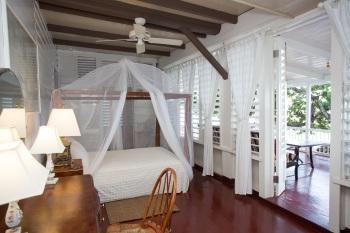 Seaside master bedroom opening onto veranda