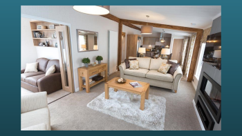 Entering from the front patio into the open plan lounge and kitchen with little snug room