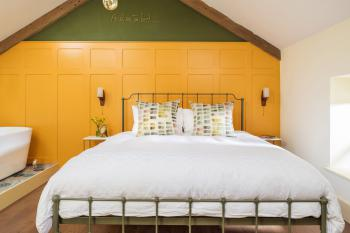 Panelled bedroom with Super King size bed and luxury linen