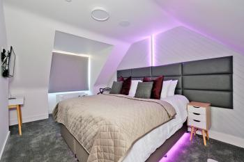 Top Right bedroom, each with Smart TVs, integrated LED lighting for reading and night mode tred lighting
